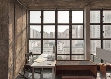 Expansive windows bring a flood of natural light into the home office