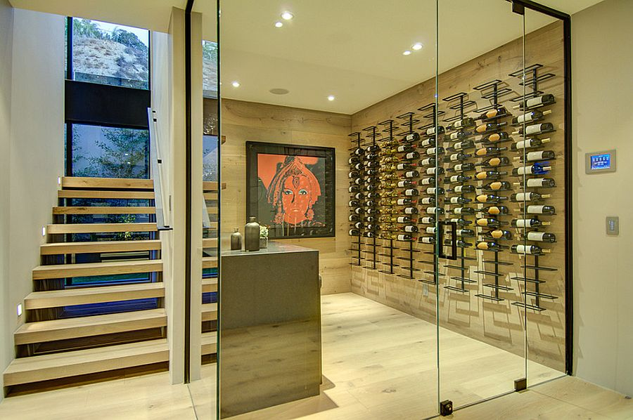 Expansive wine cellar under the staircase [From: Meridith Baer Home]