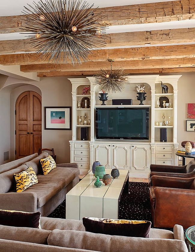 Exposed ceiling beams and Spike chandeliers add contrasting textures to the living room