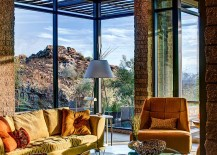 Exposed masonry and glass shape the stylish mountain home