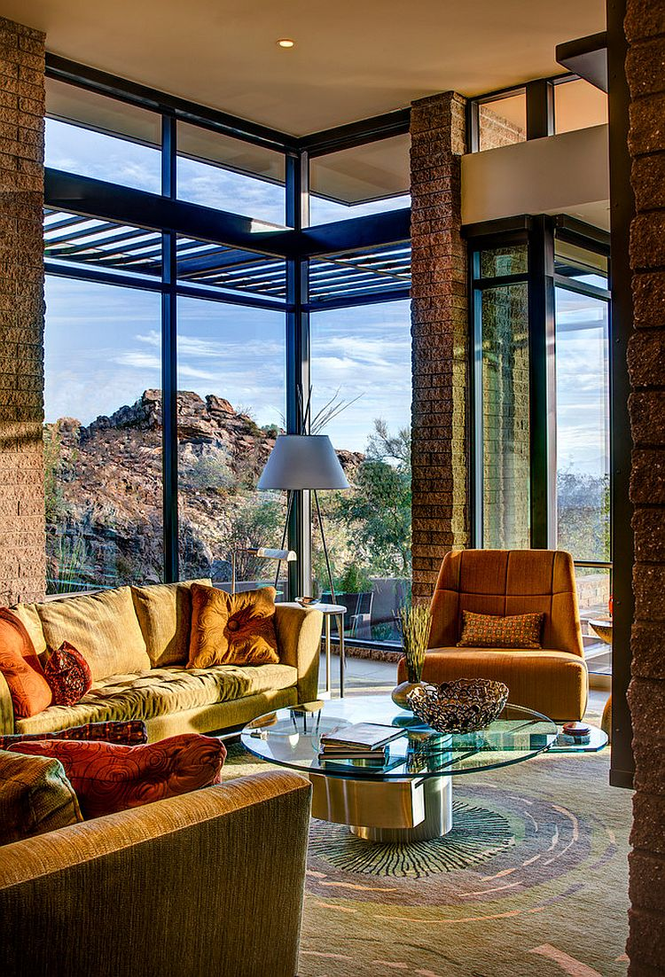 Exposed masonry and glass shape the stylish mountain home