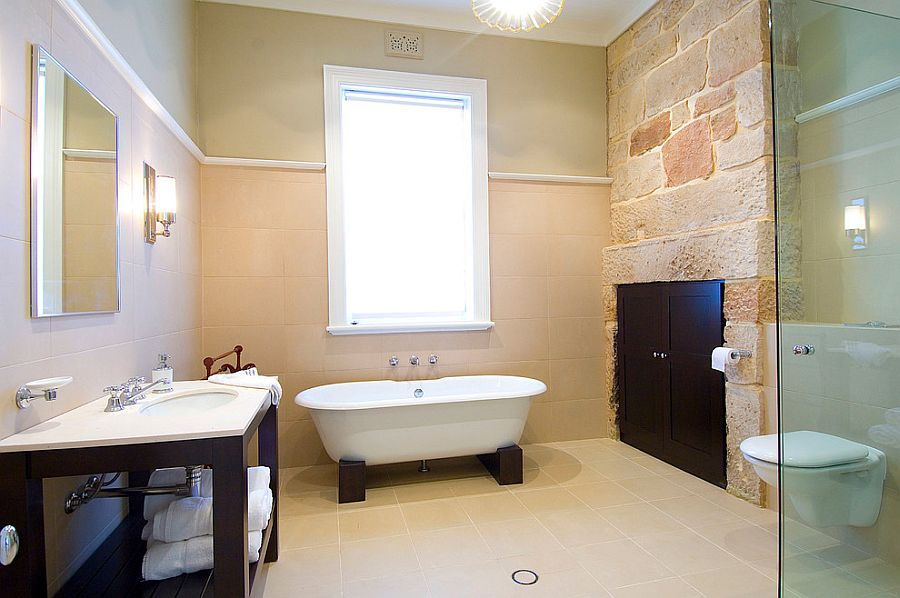 Exposed stone inside the renovated bathroom adds old world charm [Design: POC+P architects]