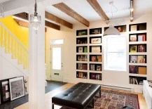 Exposed-wooden-beams-bookshelves-and-art-work-give-the-interior-a-distinct-character-217x155