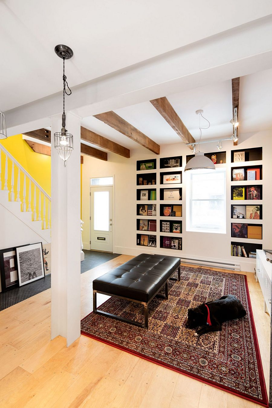 Exposed wooden beams, bookshelves and art work give the interior a distinct character