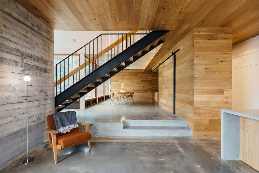 Extensive wooden cladding creates an inviting ambaince inside the functional Aussie home
