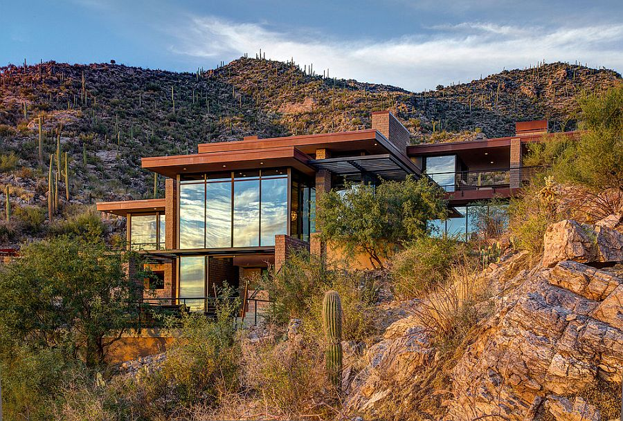 Exterior of the home in Tucson blends in with the natural mountain landscape