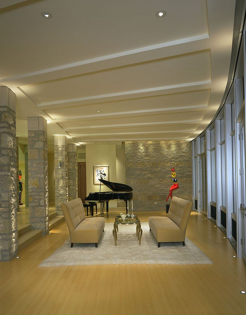 Fabulous family room with stone walls and in-floor lighting [Design: Deep River Partners]