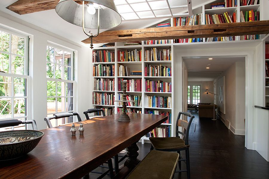 Fabulous farmhouse style dining room with built-in bookshelves in the background [Design: Sullivan Building & Design Group]