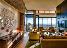 Fabulous-living-room-offers-a-great-view-of-the-city-and-the-distant-mountain-ranges-217x155