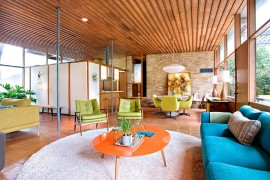 Fabulous midcentury modern living room with original brick walls and flooring from 1950s