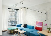 Fabulous modular sofa in blue adds color to the eclectic living space