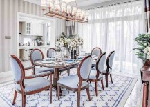 Fabulous wallpaper, drapes and rug in the dining room stitches together contrasting textures