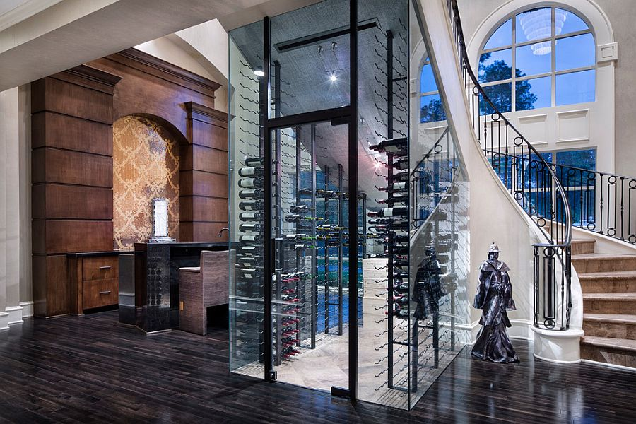 Fabulous wine cellar under the curvy staircase [Design: JAUREGUI Architecture Interiors Construction]