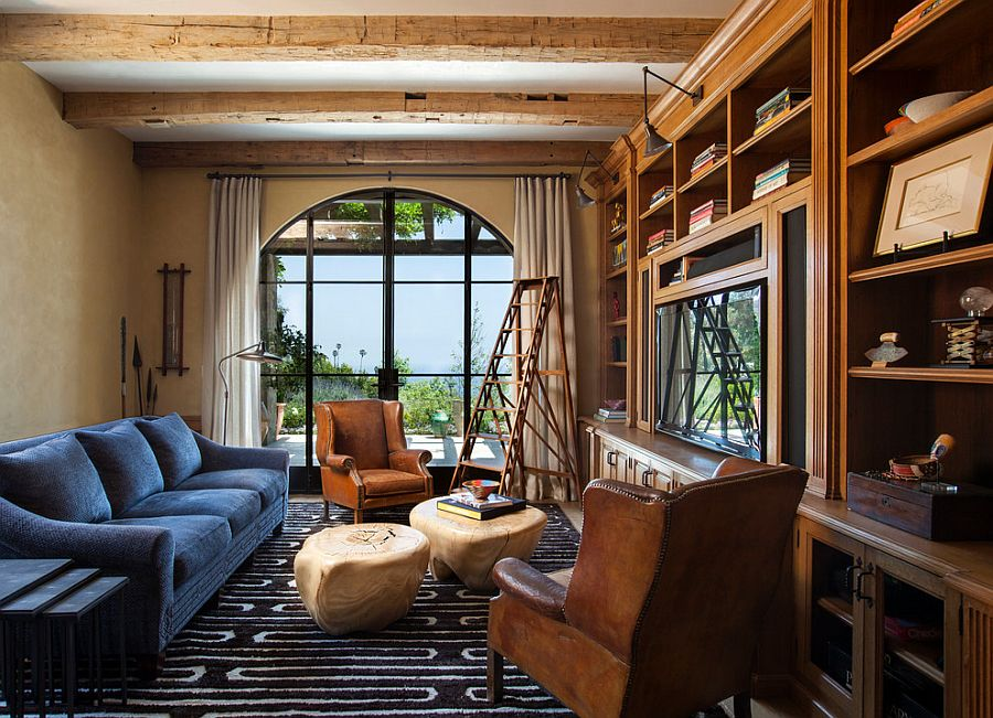 Family room and home library with textured walls and exposed wooden ceiling beams