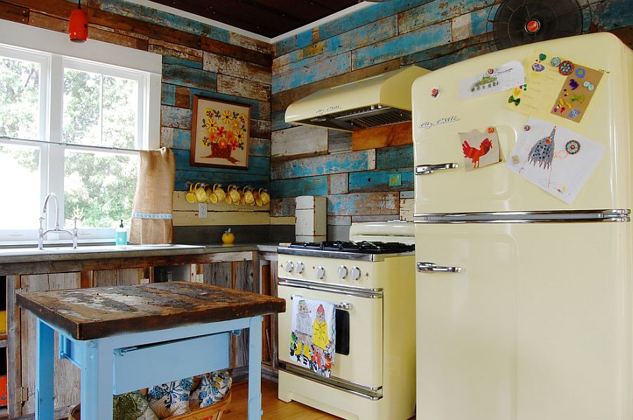 Farmhouse and shabby chic styles meet in this kitchen with reclaimed wood walls