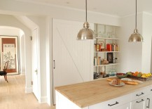 Farmhouse kitchen with a barn door for the pantry