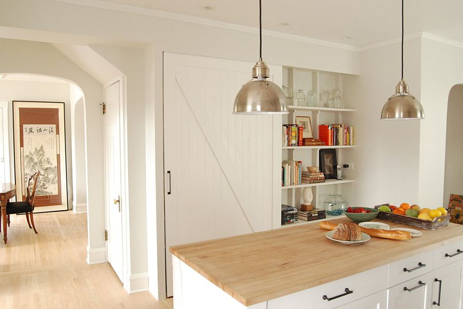 Farmhouse kitchen with a barn door for the pantry [Design: Rebekah Zaveloff – KitchenLab]