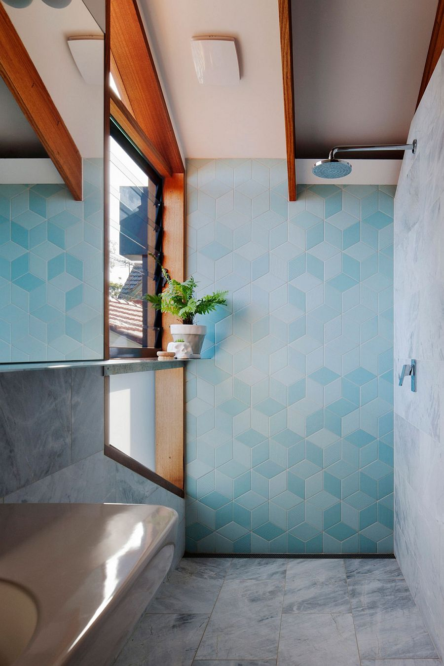 Fascinating use of blue tiles to bring texture and pattern to the modern bathroom