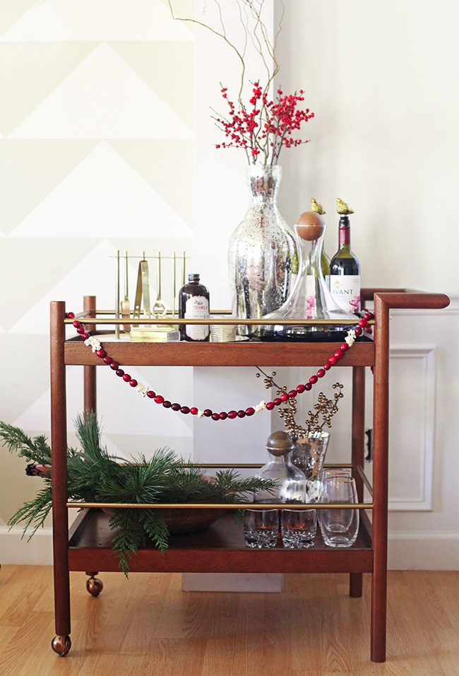 Festive holiday bar cart from In Honor of Design Stocking Your Holiday Bar Cart