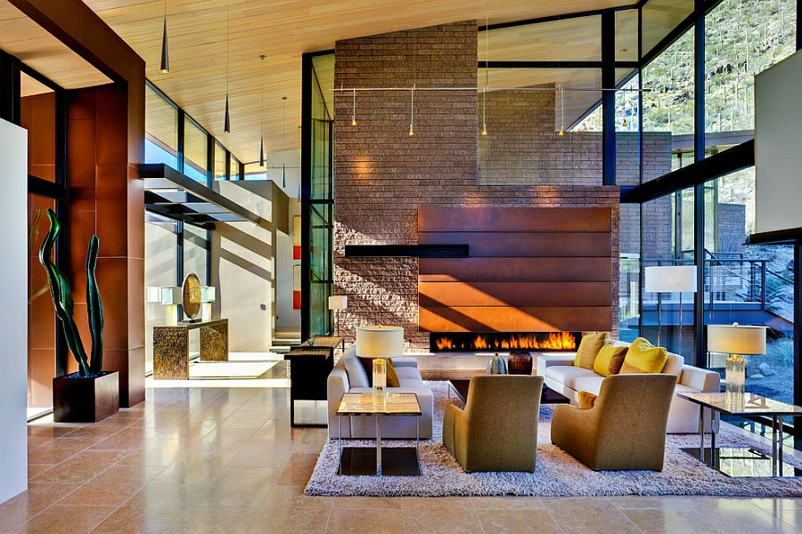 Fireplace creats a warm and elegant focal point in the double hieght living room