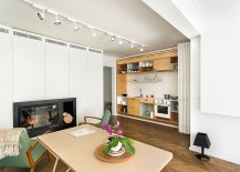 Foldable-white-doors-open-up-to-reveal-the-space-conscious-kitchen-217x155