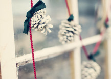 Frosted-pinecone-garland-with-green-ribbon-and-red-rope-217x155