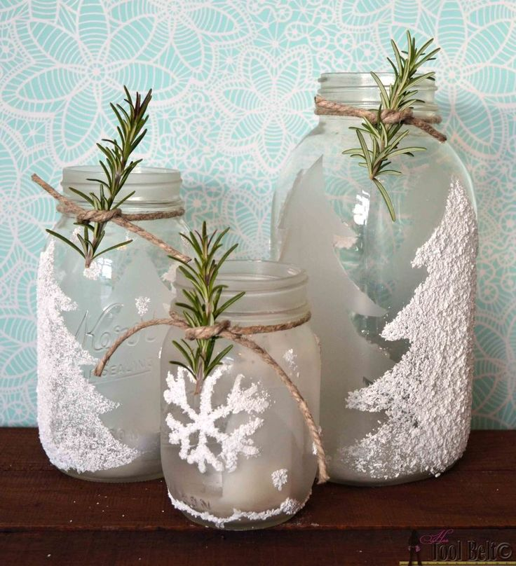Frosted winter-themed mason jar candle holders with epsom salts