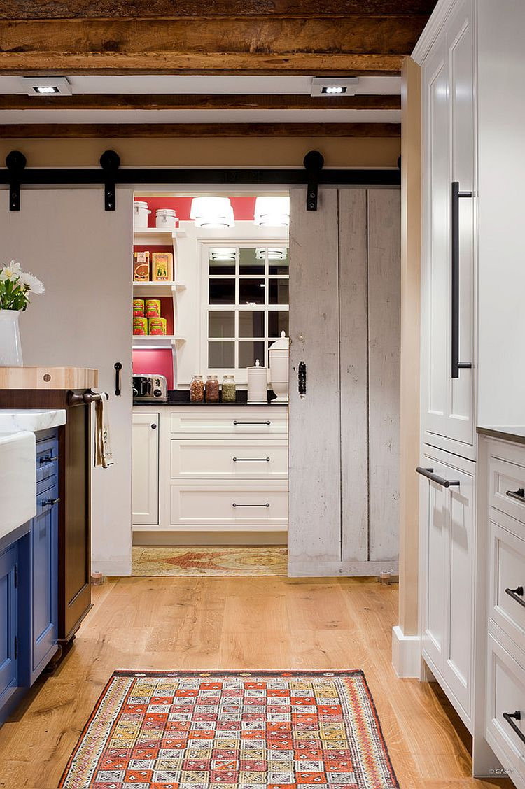 View in gallery Full-size pantry with counters and workzone hidden behind  sliding barn-style doors [