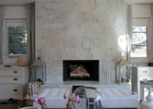 Glamorous living room with a marble fireplace