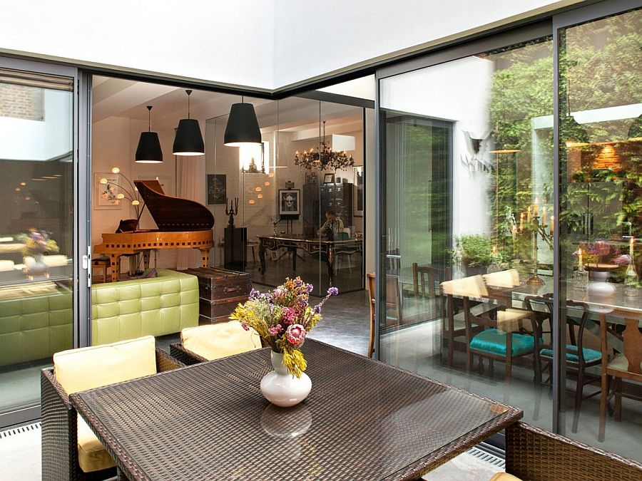 Glass doors and a modern makeover transform the Victorian warehouse into a lovely modern home