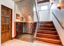 Glass-walls-turn-the-space-under-the-stairs-into-a-lovely-wine-storage-area-217x155