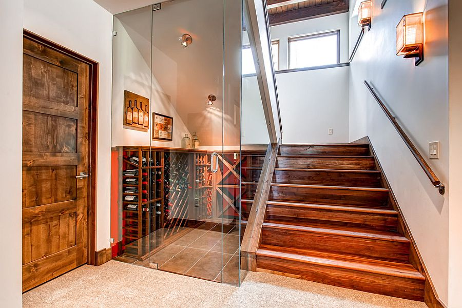 Glass walls turn the space under the stairs into a lovely wine storage area