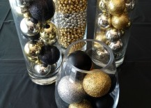 Gold black and silver Christmas ornaments in glass cylinders 217x155 20 Chic Holiday Decorating Ideas with a Black, Gold, and White Color Scheme