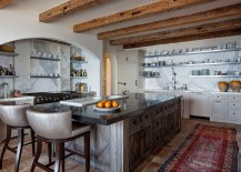 Gorgeous Mediterranean kitchen with antique reclaimed terra cotta flooring and marble counters
