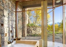 Gorgeous-bathroom-with-natural-stone-wall-and-sunken-tub-217x155
