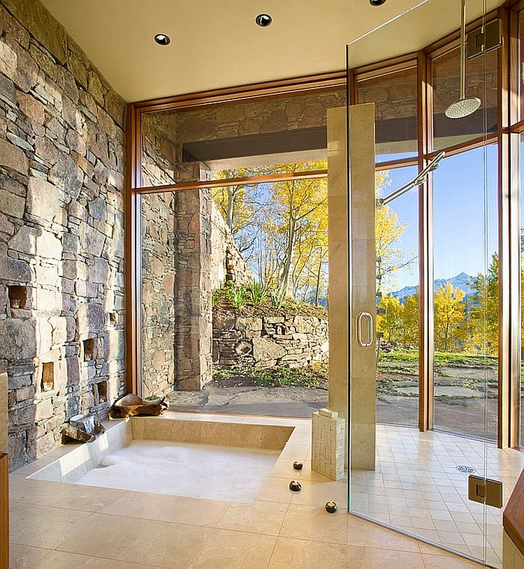 Gorgeous bathroom with natural stone wall and sunken tub