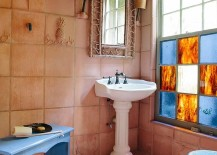 Gorgeous rustic bathroom with terracotta tiles for the wall and flooring