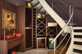 Gorgeous under staircase wine storage idea