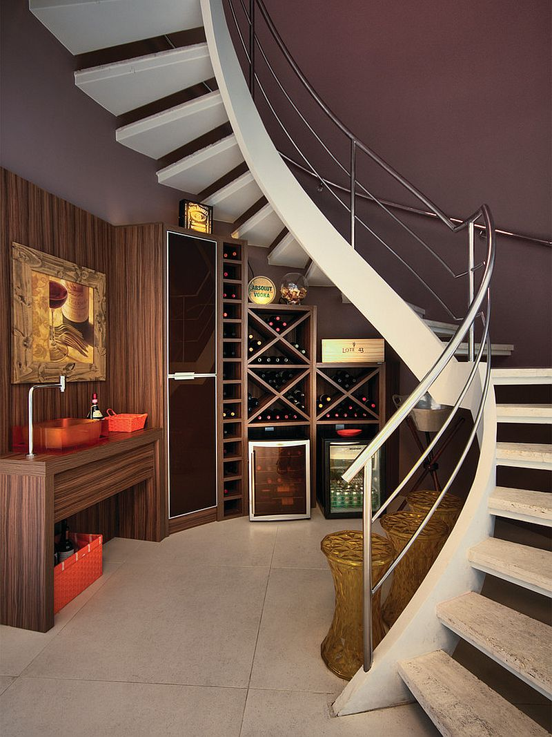 Gorgeous under staircase wine storage idea [Design: Bruno Arquitetura]