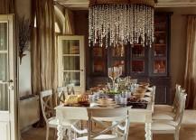 Grand chandelier and cozy color scheme for the inviting dining room [Design: Claudia Pelizzari Interior Design]