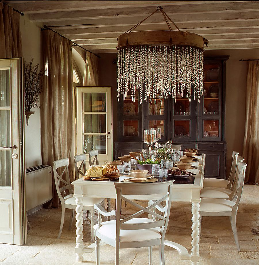 grand chandelier and cozy color scheme for the inviting dining room  design  claudia pelizzari