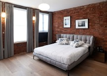 Gray brings contemporary elegance to the bedroom with exposed brick walls