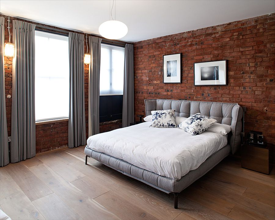 Gray brings contemporary elegance to the bedroom with exposed brick walls [Design: Peter Landers Photography]