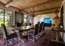 Herringbone pattern terra-cotta brickettes ceiling takes the dining room visual to a whole new level