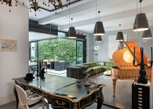 Home-office-with-a-Victorian-desk-and-frameless-glass-walls-217x155