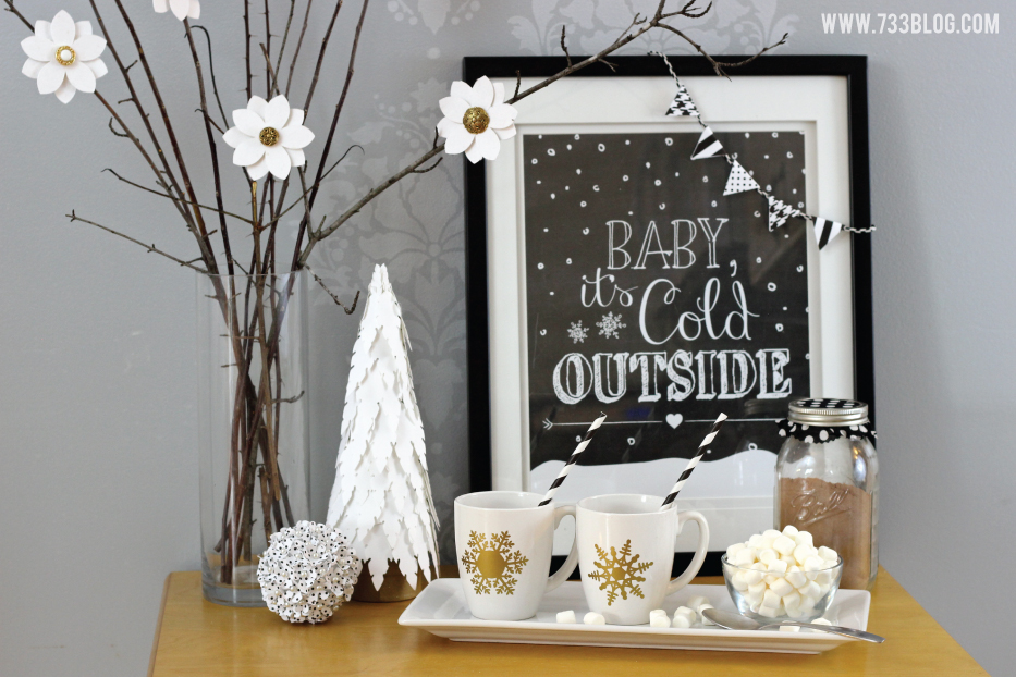 Hot chocolate bar with decor in gold, black, and white