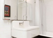Industrial-bathroom-in-white-with-vintage-bathtub-and-shower-area-217x155