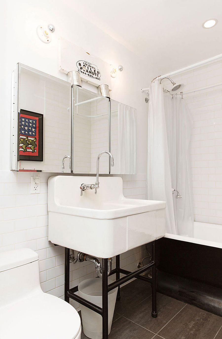 Industrial bathroom in white with vintage bathtub and shower area