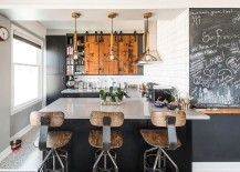 Industrial kitchen with smart cabinets featuring sliding wooden doors
