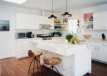 Industrial-style lighting in a kitchen with marble details